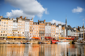 Landscape view of the harbour in Honfleur, famous french town in Normandy, during the morning light Fototapete