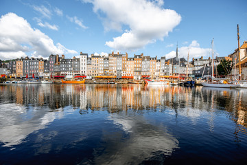 Landscape view of the harbour in Honfleur, famous french town in Normandy, during the morning light Fotomurales