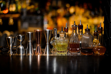 Deurstickers Cocktail Set of barman tools including jiggers and little bottles with liquor