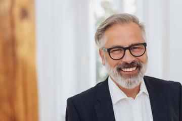 Portrait of an elegant middle-aged man smiling