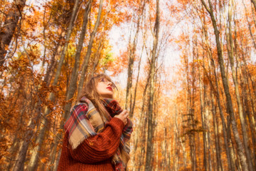 Young girl in autumn season in the park, shot of a girl with scarf in fall outdoor