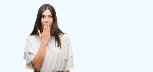 Young beautiful hispanic woman cover mouth with hand shocked with shame for mistake, expression of fear, scared in silence, secret concept