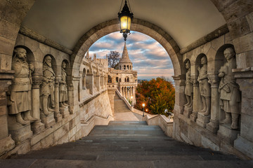 Budapest, Hungary - View on the ancient Fisherman's Bastion (Halaszbastya) at sunrise with beautiful sky and autumn foliage Wall mural