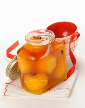 Brandy oranges with spices in a jar