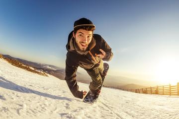 Man snowboarder playful jump trick Wall mural