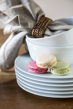 Macarons on stack of plates