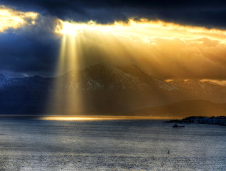 Dramatic landscape - sun over a mountain, Tromso, Norway