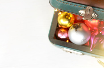 Christmas holiday travel/ open old suitcase lid and blurred silhouettes of toys and decorations top view