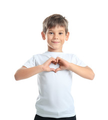 Cute little boy in t-shirt making heart with his hands on white background