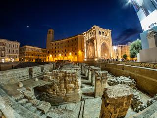Night scene with historical Roman amphitheatre architecture of Lecce City in Italy