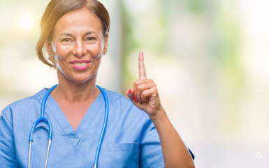 Middle age senior nurse doctor woman over isolated background showing and pointing up with finger number one while smiling confident and happy.