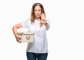 Middle age hispanic woman moving holding packing box over isolated background with open hand doing stop sign with serious and confident expression, defense gesture