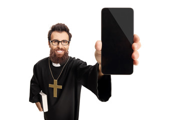 Young priest holding a mobile phone