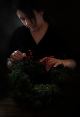 Woman decorating wreath