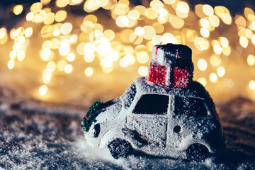 Car with Christmas gifts on the roof