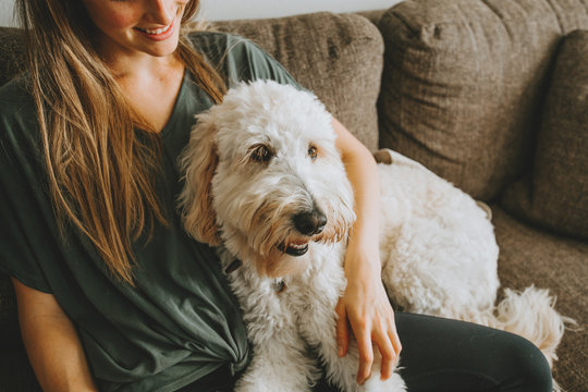 Girl with her dog at home