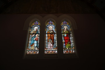 Church stained glass window with religious figures