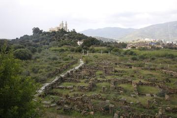 Church on top of a hill behind a Roman ruin