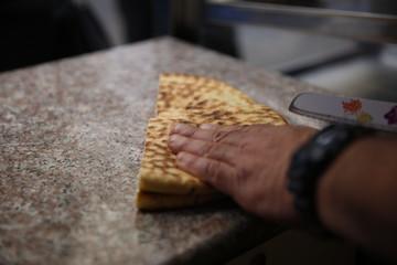 Cutting chapati naan bread