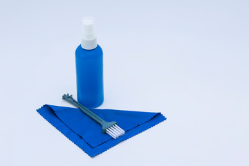 Cleaning kit for lenses and dslr camera sensors, blower, brush and microfiber cloth isolated on white background.