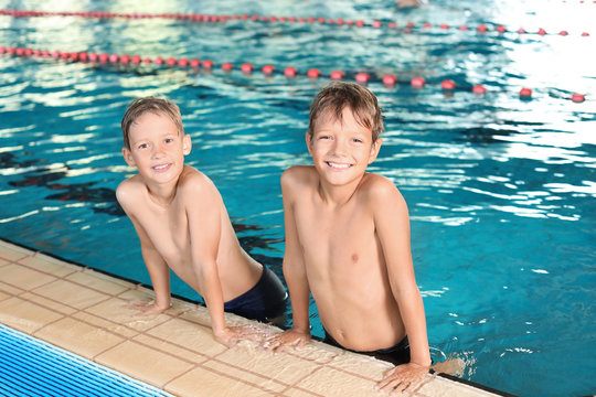 Cute little boys in indoor swimming pool