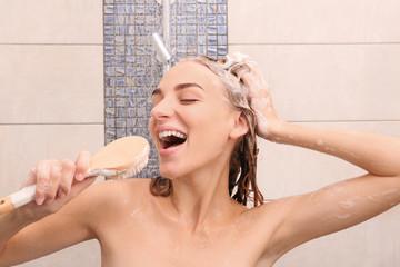 Beautiful young woman singing in shower at home Fotobehang