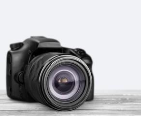 Professional camera on white background