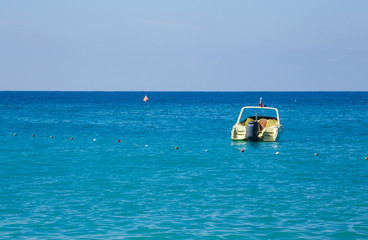 Yellow Boat in Beautiful Blue Sea. Mediterranean Sea.