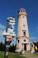 Tower and tourist routes signs on Great Owl (Wielka Sowa)(Hohe Eule)  mountain height of 1015 metres (3,329 ft) is the highest peak of the Owl Mountai