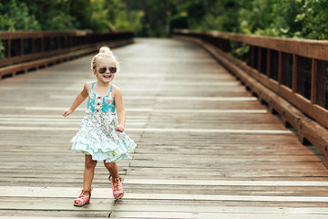 Girl walking on a bridge