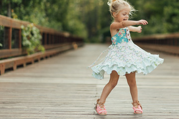 Girl dancing on a bridge