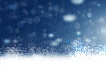 Abstract blurred festive winter christmas or Happy New Year background with shiny blue and white bokeh lighted snow landscape. Space for your design. Card concept.