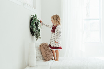 Girl touching a wreath