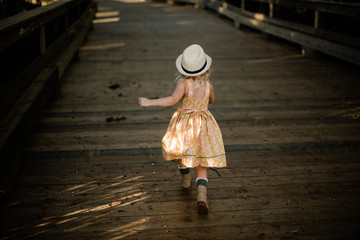 Girl walking on bridge