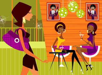 Three women in a nightclub