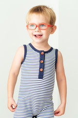 Smiling boy with orange eyeglasses