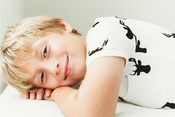 Smiling boy lying down