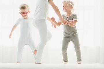Three siblings playing