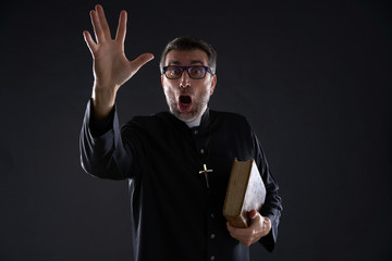 Mad crazy priest surprised expression