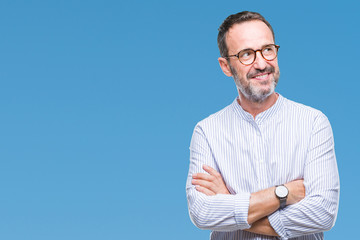 Middle age hoary senior man wearing glasses over isolated background smiling looking side and staring away thinking.