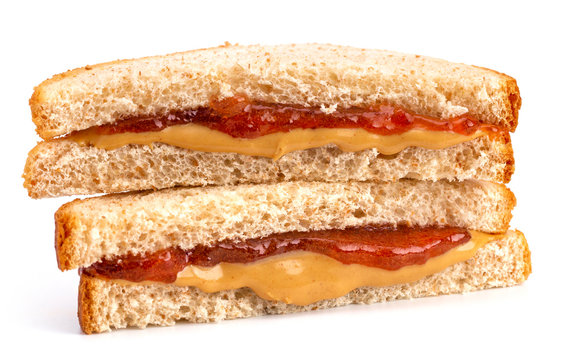 A Classic Peanut Butter and Strawberry Jelly Sandwich on Wheat Bread