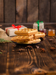 fresh belgian Tasty waffles and gifts on a wooden background. top view.