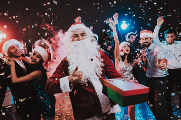 Man in Santa Claus Costume on New Year Party.