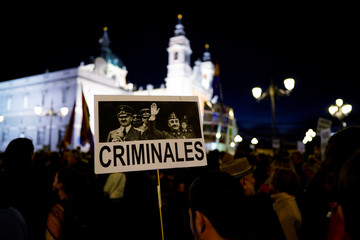 People attend a protest calling the government to ban the burial of Spanish dictator Francisco Franco in Almudena Cathedral in Madrid
