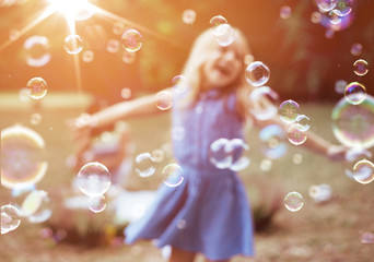 Keuken foto achterwand Artist KB Cheerful little girl enjoying bubble blowing