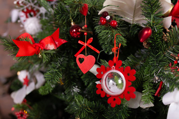 Close up of christmas toys on Christmas tree. Happy New Year and Christmas concept.