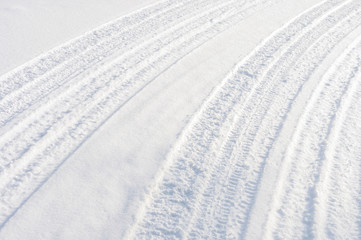 Car tire tracks in fresh snow