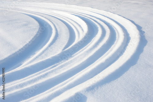 Snowmobile tracks and tire tracks in snow