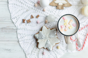 Cup of cocoa with marshmallows and glazed christmas gingerbread