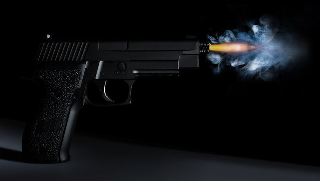 shot from a handgun with a bullet in motion, fire and smoke